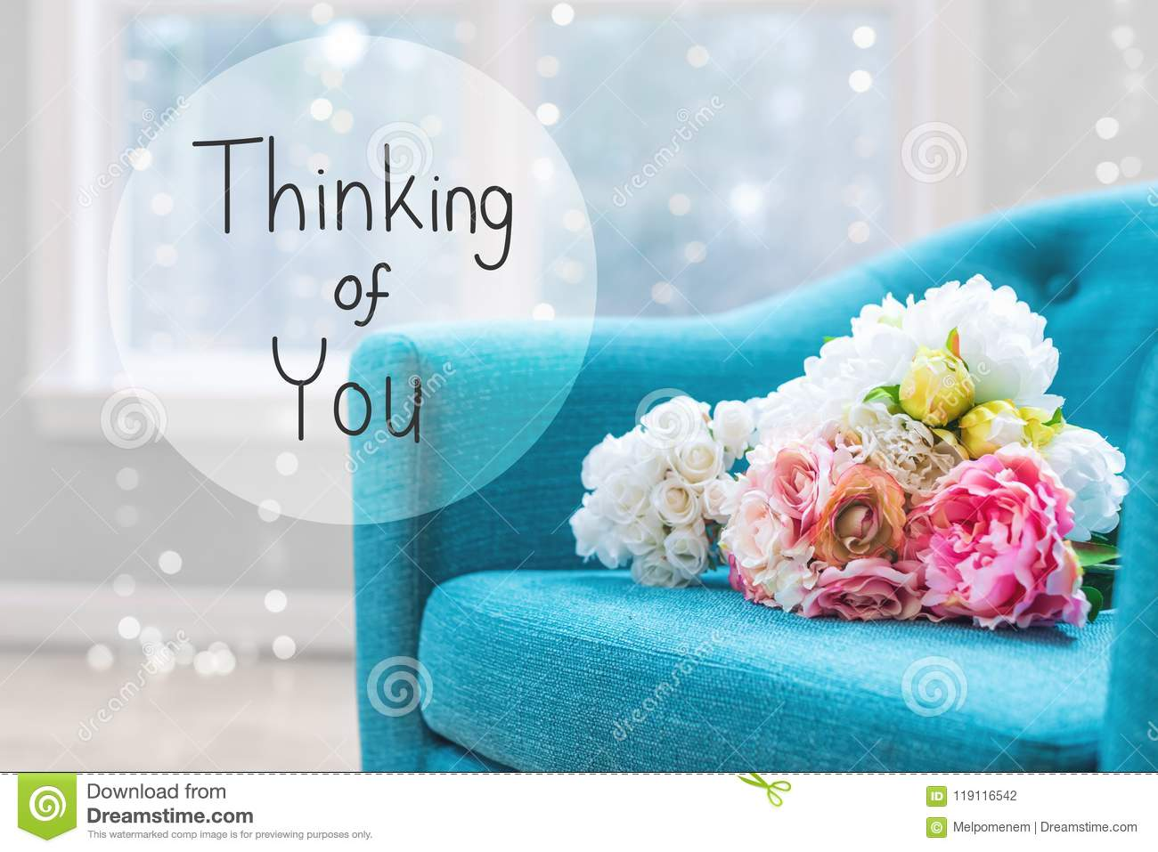 thinking of you message with flower bouquets with chair stock photo
