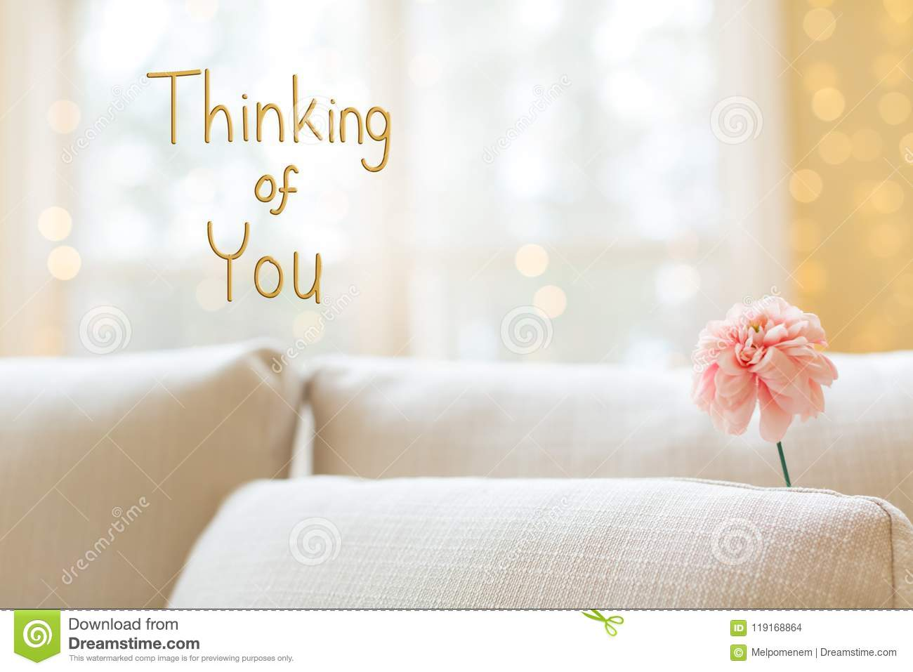 thinking of you message with flower in interior room sofa stock