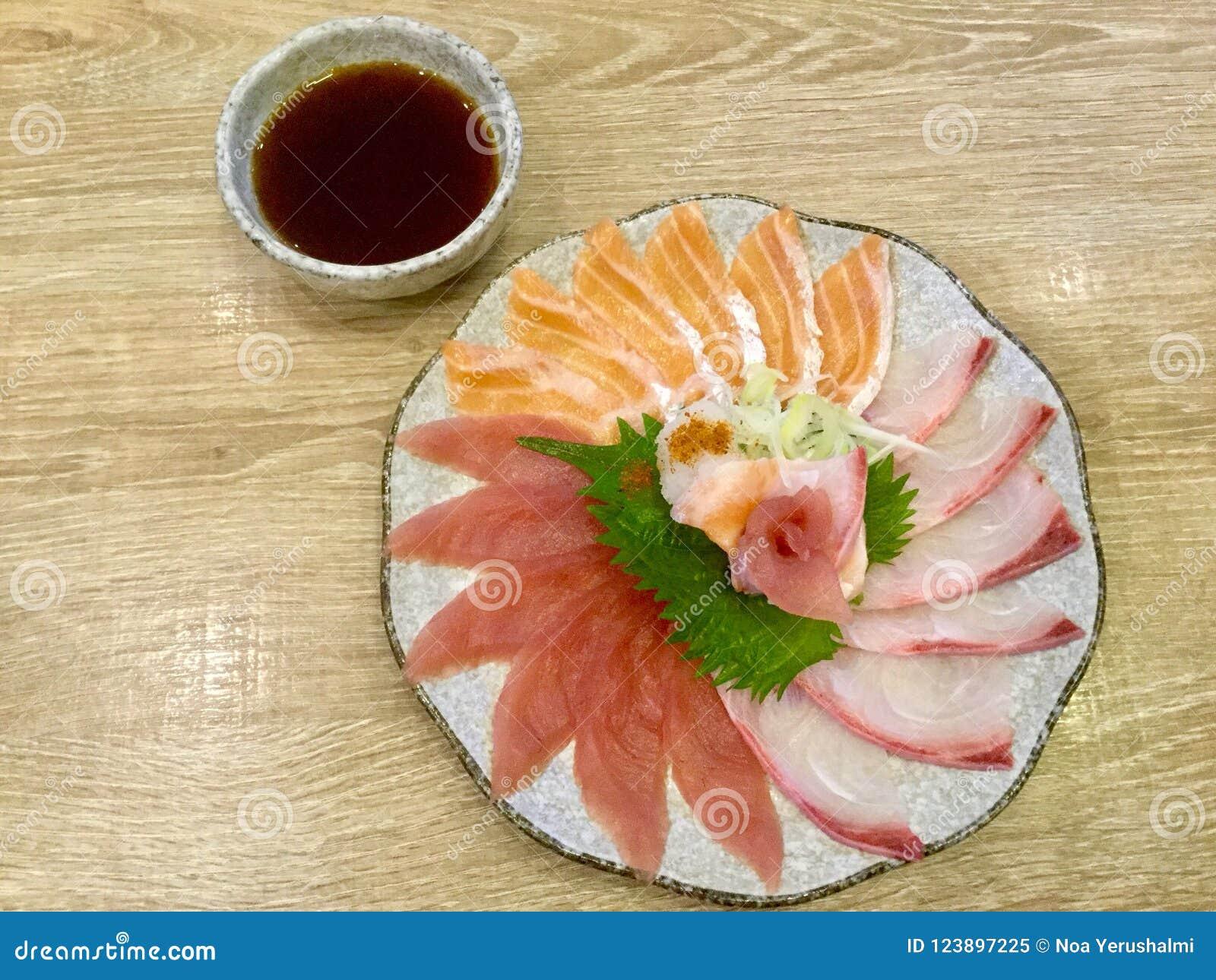 Thinly Sliced Sashimi  Tuna  Salmon  Yellowtail  Japanese Delicacy