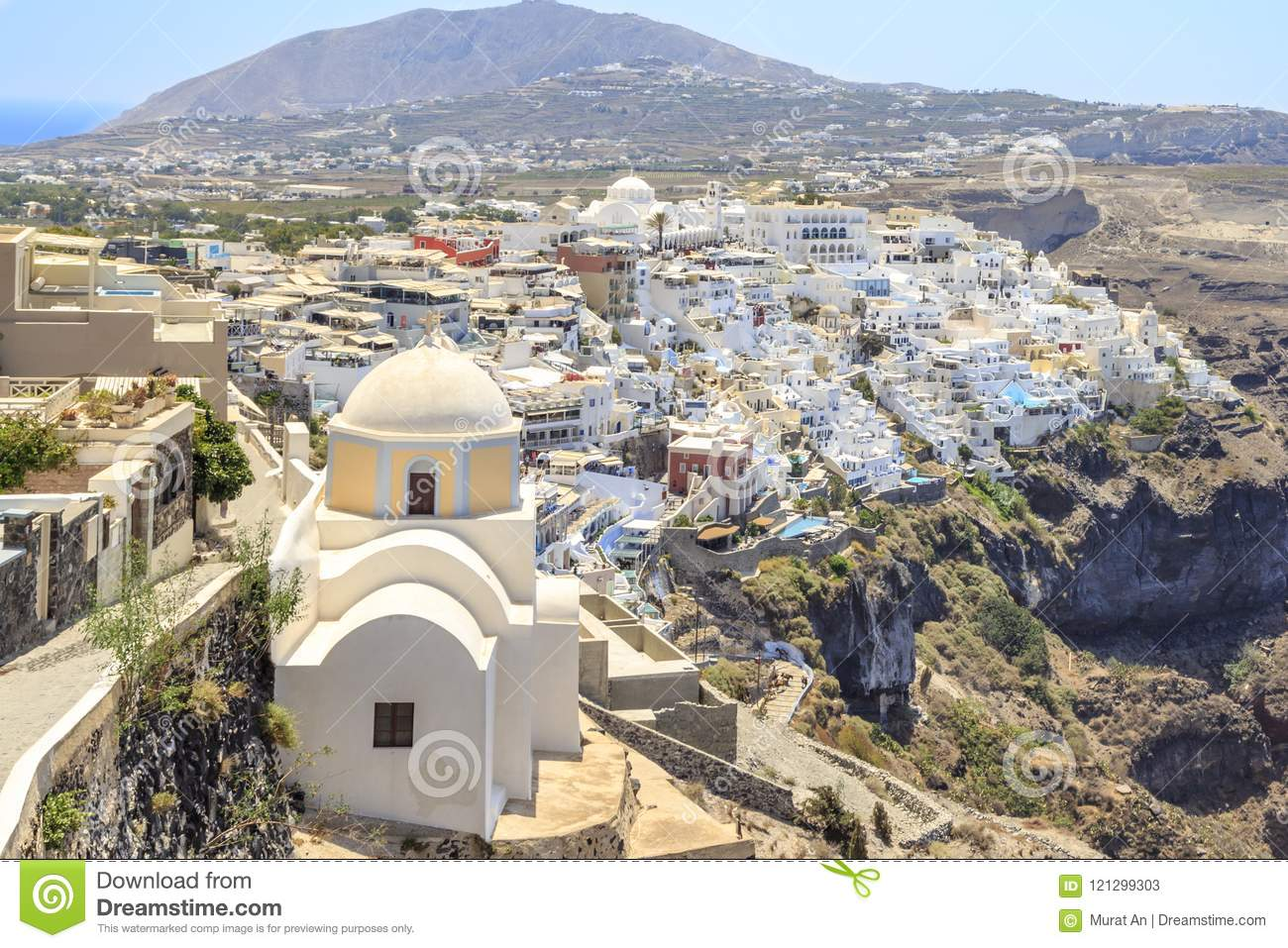 Thira town with St. Stylianos church during daytime in Santorini, Greece