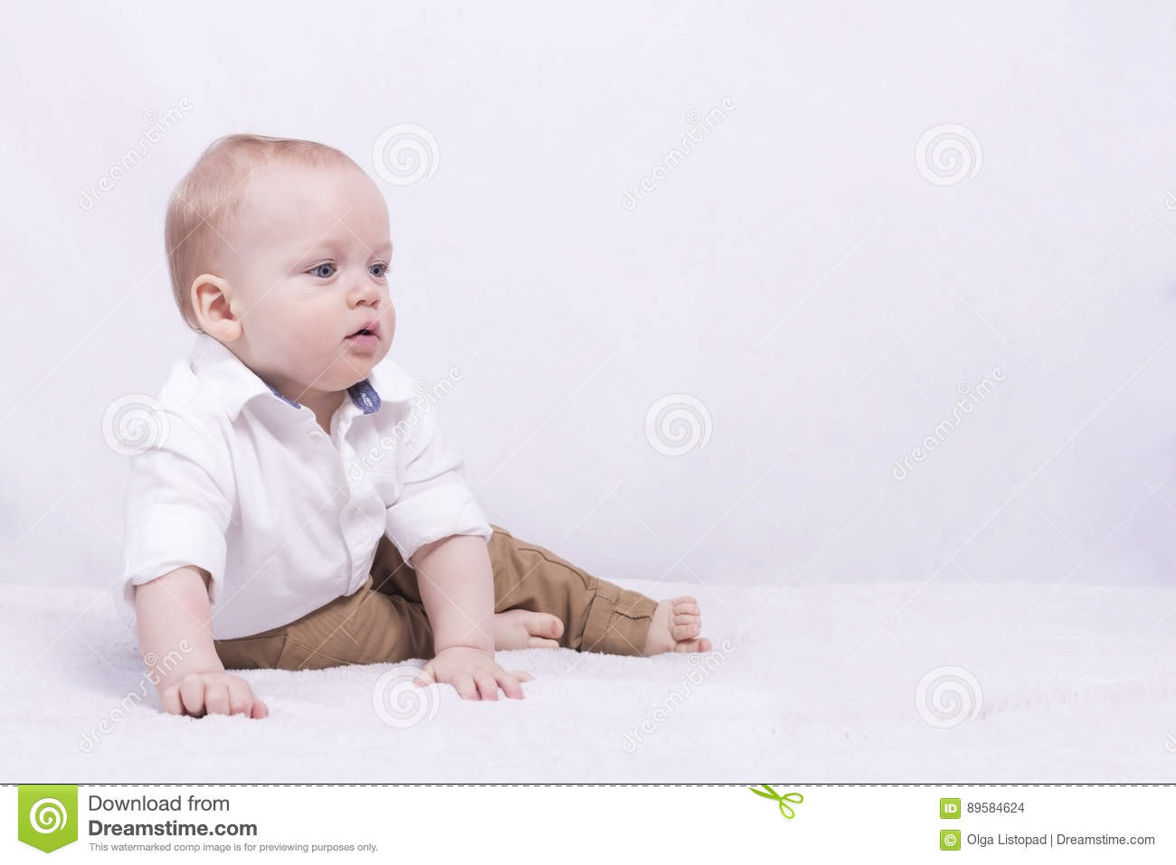 1d2d5478f Thoughful Big-eyed Toddler Looking Away And Sitting On The White ...