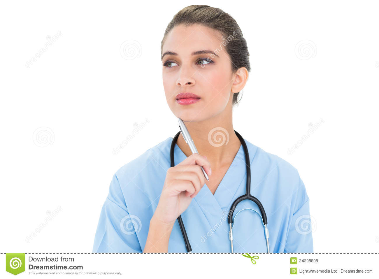 Thoughtful Brown Haired Nurse In Blue Scrubs Holding A Pen