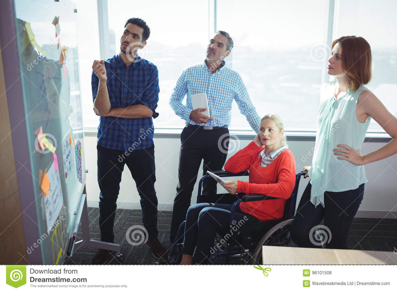 Thoughtful business entrepreneurs looking at whiteboard