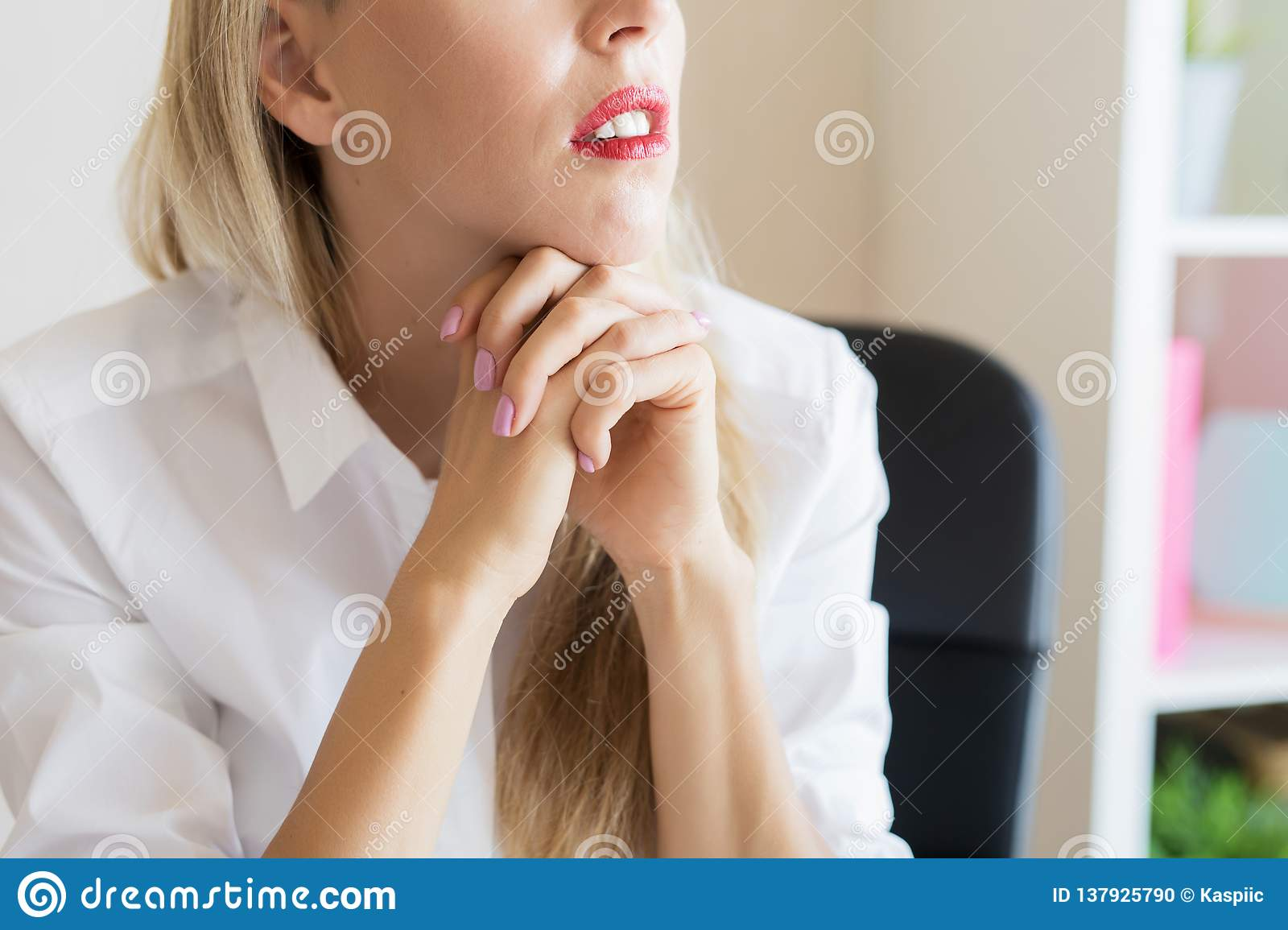 Thoughtful woman at work