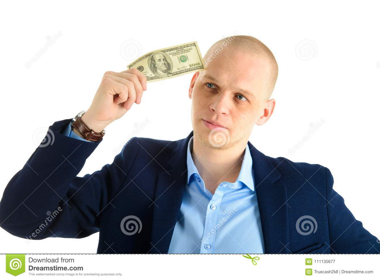 Thoughtful businessman in suit on white background holding cash. Thinking about making money.