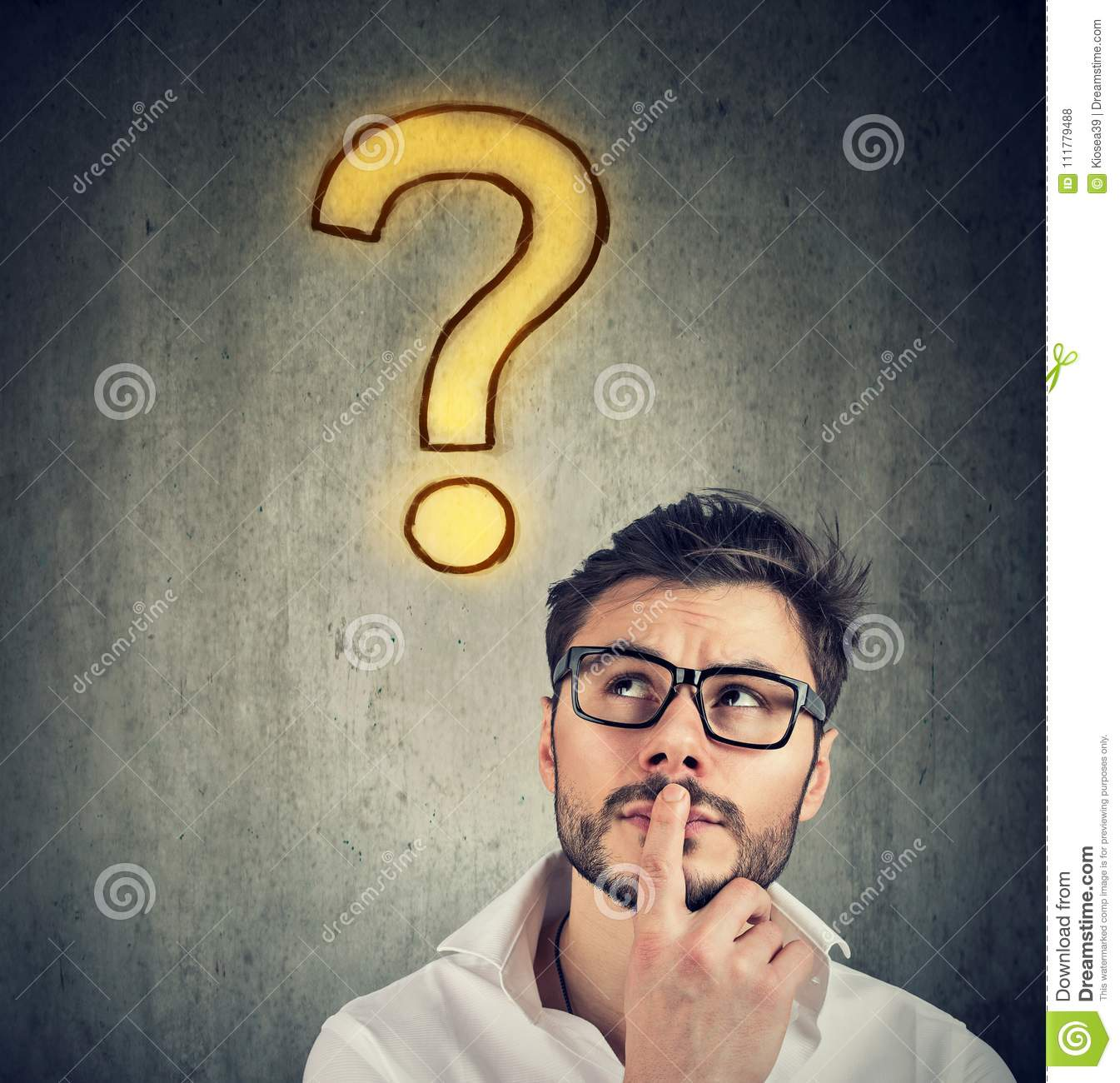 Confused handsome man has a question and no answer