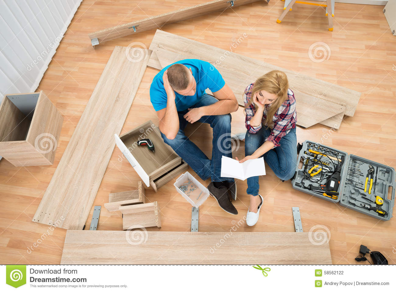 Thoughtful couple with disassembled furniture stock photo for Furniture that can be disassembled