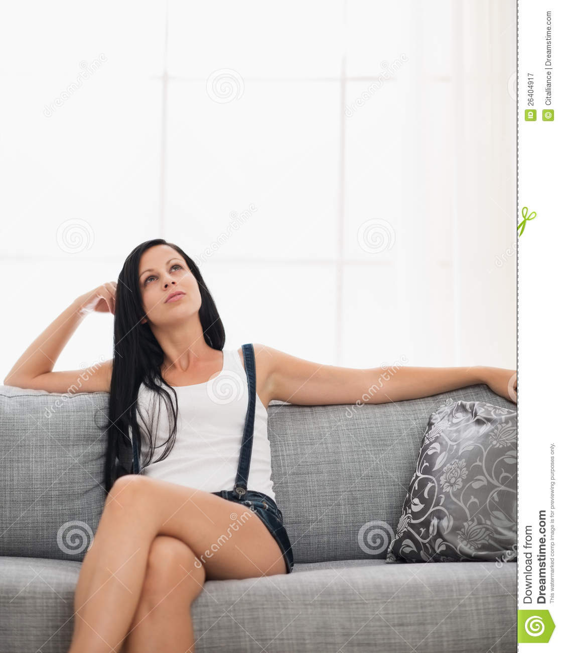 Thoughtful Girl Sitting On Couch In Living Room Royalty Free Stock ...