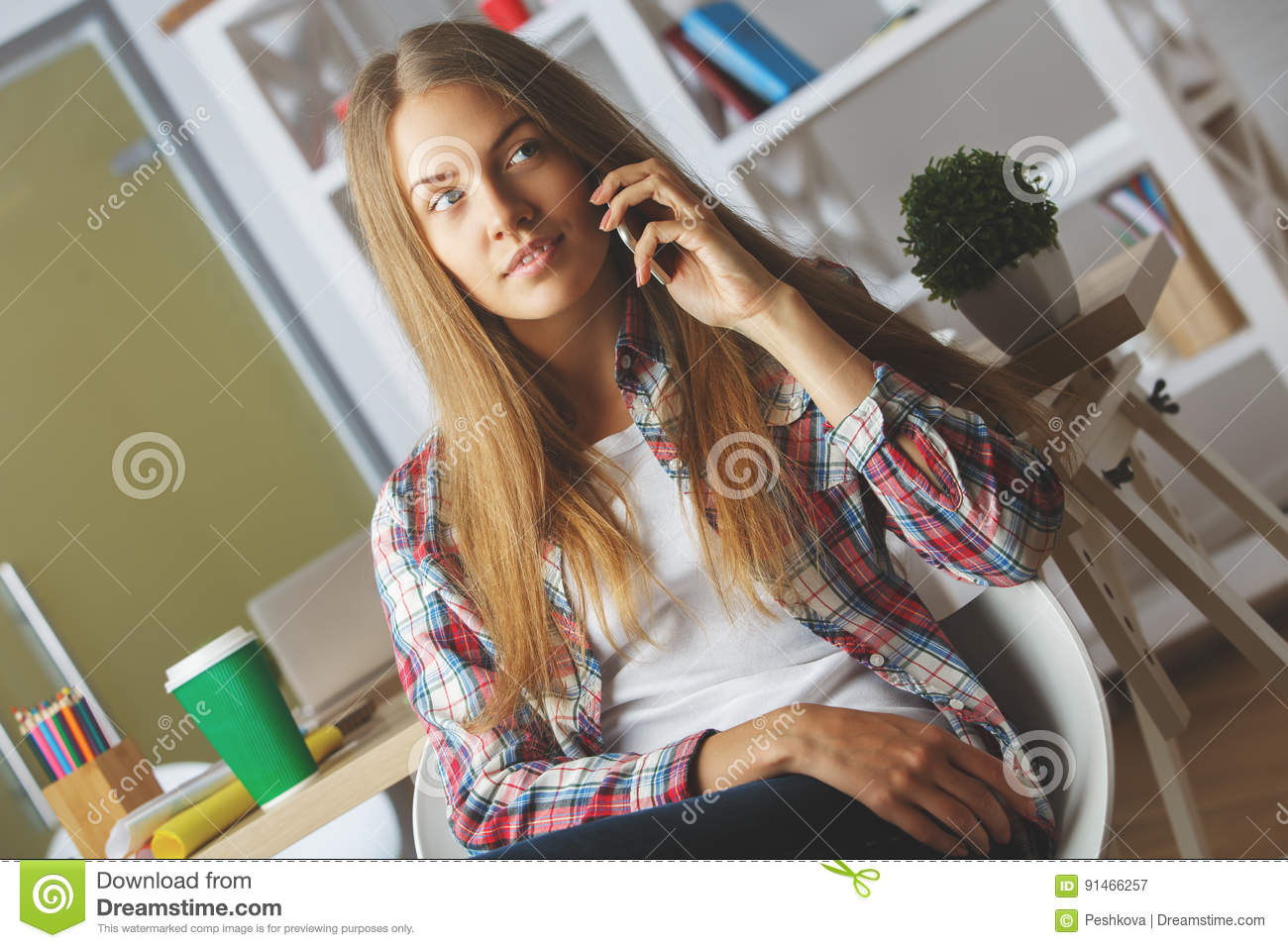 Thoughtful girl talking on the phone