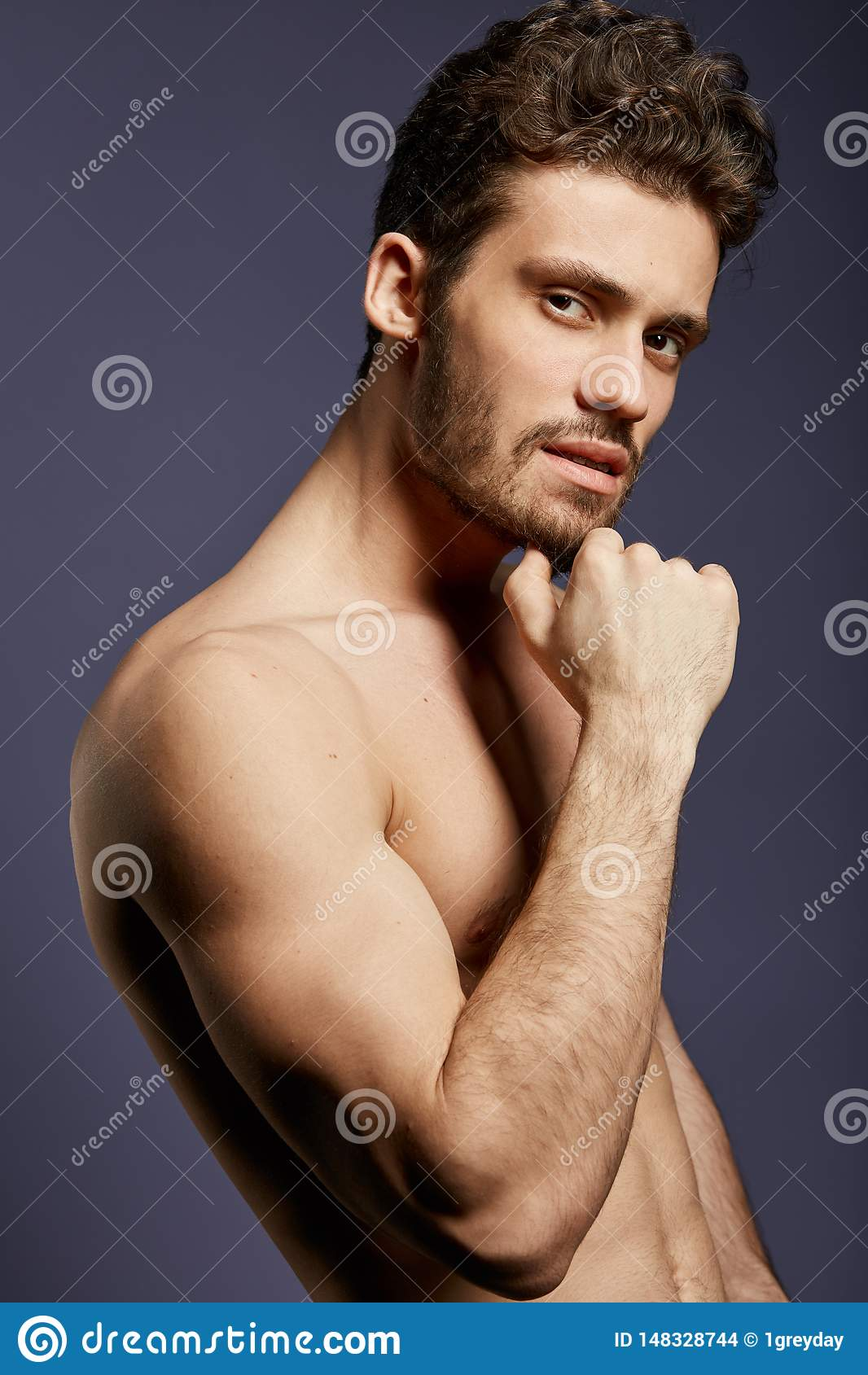 Thoughtful handsome athlete making serious decision