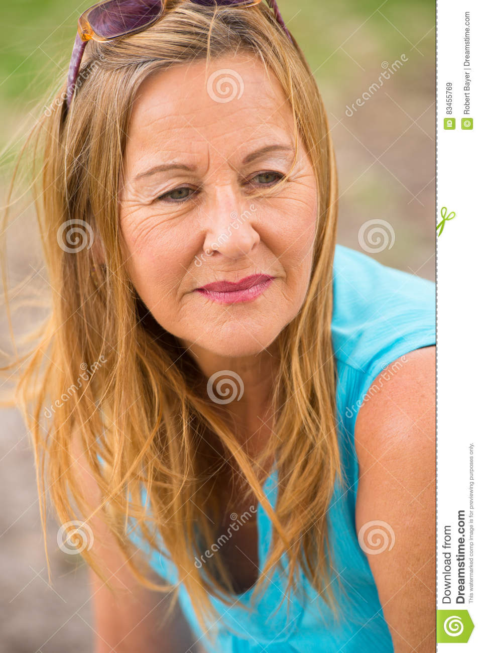 thoughtful lonely mature woman outdoor stock image - image of