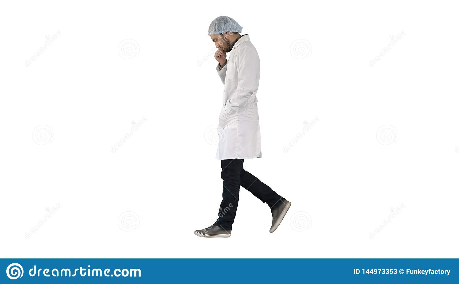 Thoughtful male doctor walking on white background.