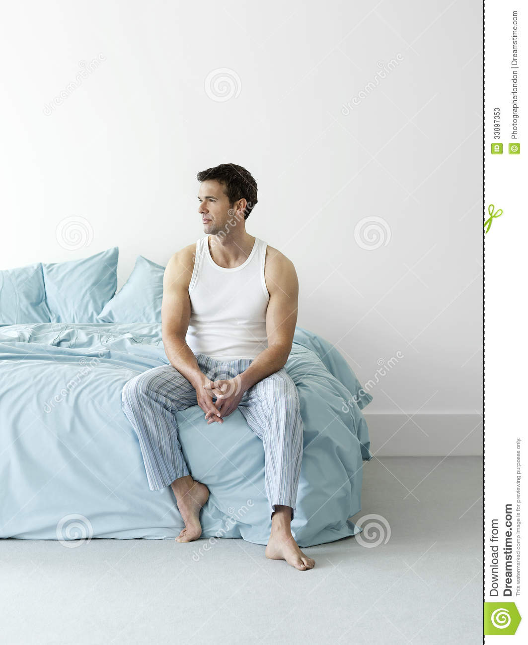 Thoughtful man in nightwear sitting in bed stock photos image 33897353 - Man bedroom photo ...