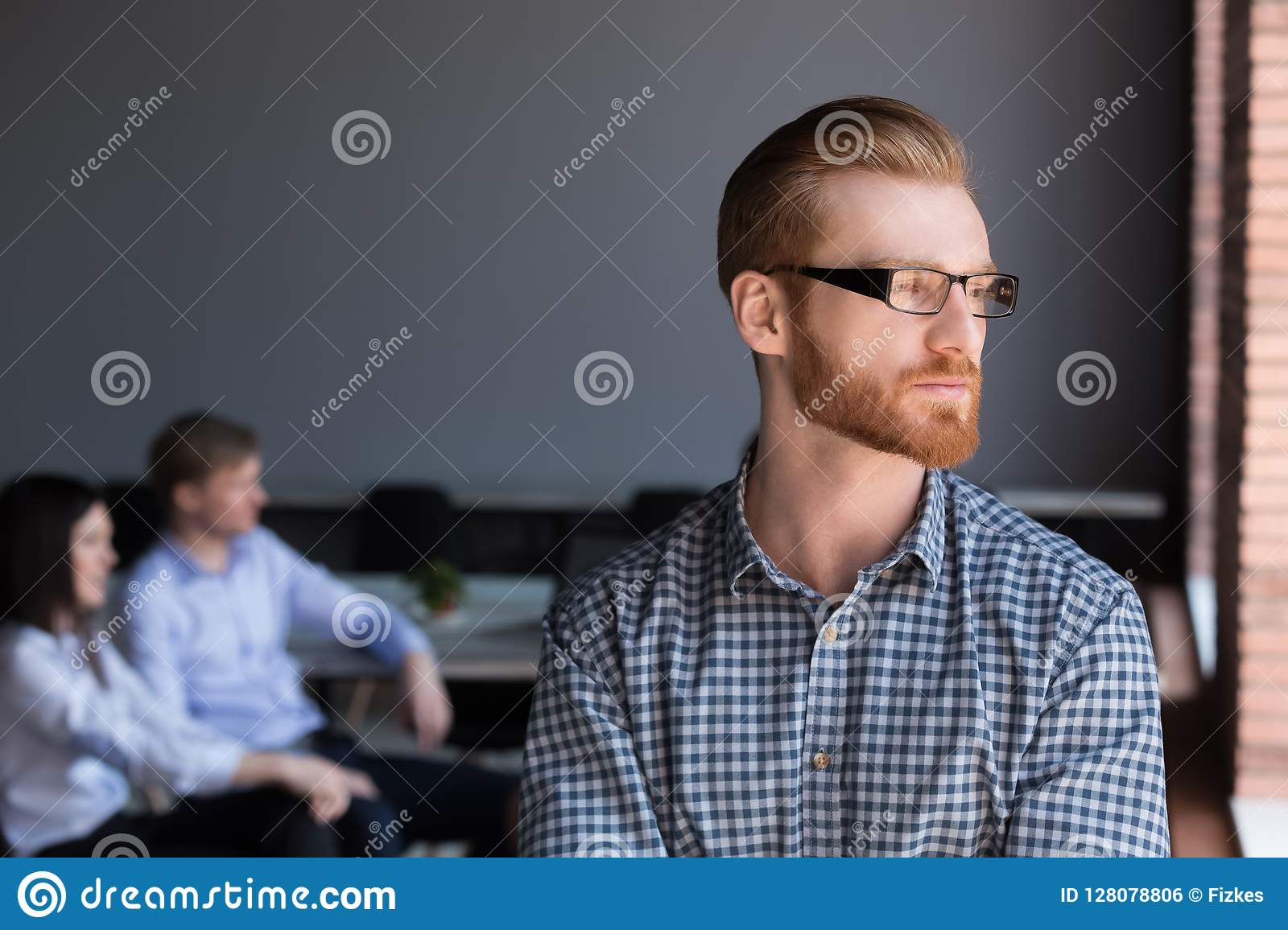 Thoughtful serious businessman looking away thinking of future b