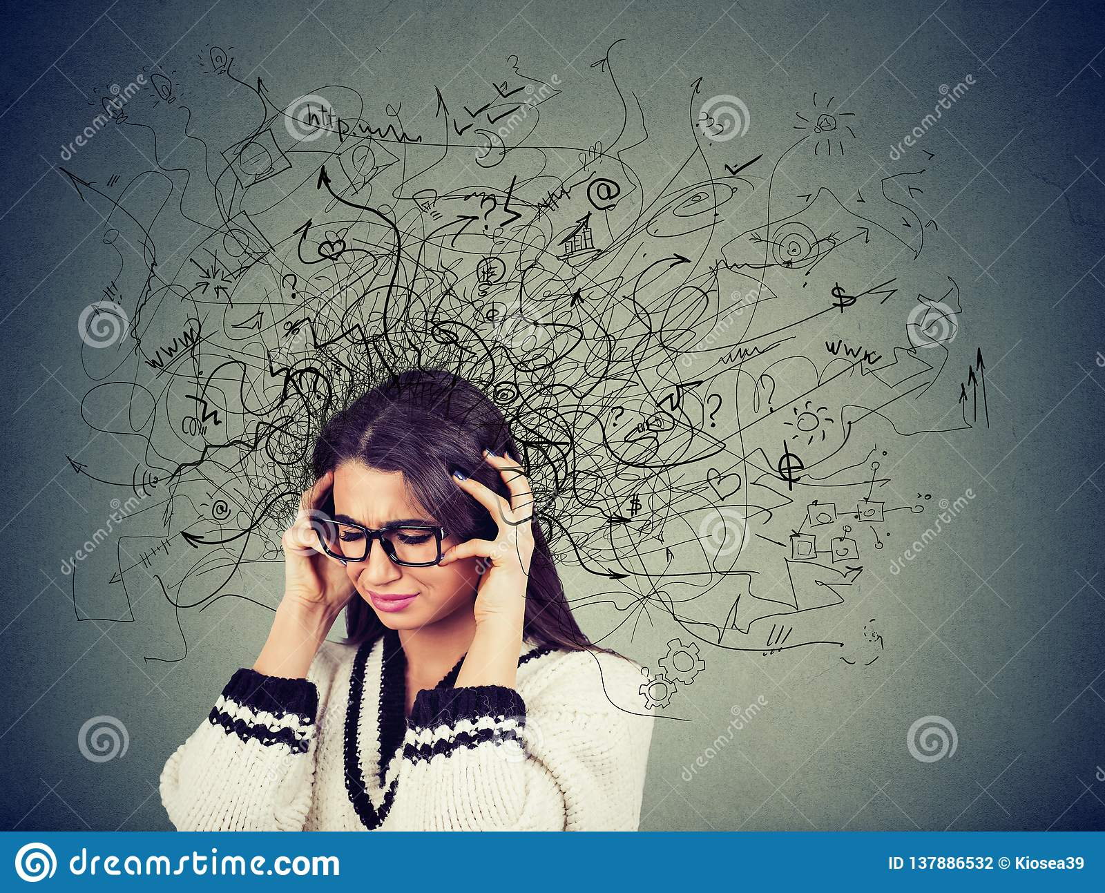 Thoughtful stressed young woman in glasses with a mess in her head