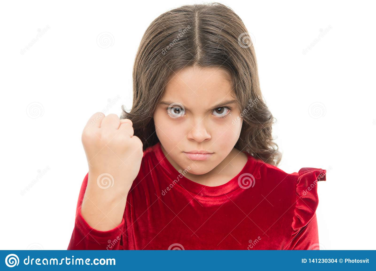 Threatening with physical attack. Kids aggression concept. Aggressive girl threatening to beat you. Dangerous girl. You