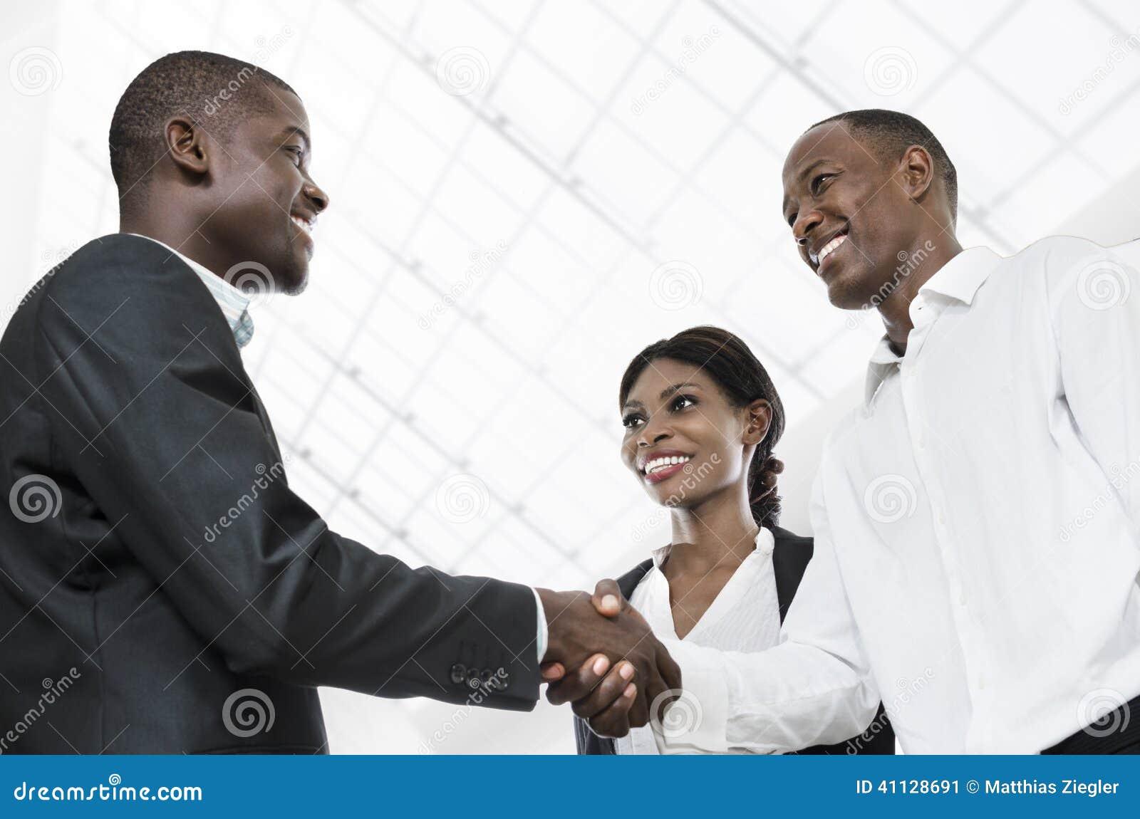 Business people handshake greeting deal at work photo free download - Three African Business People Handshake Stock Image