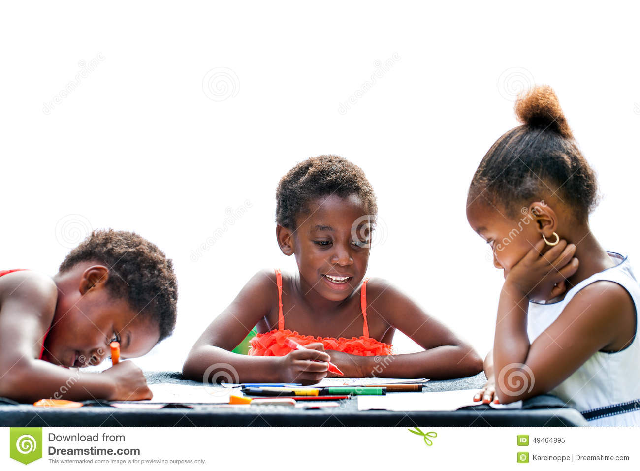 Three African kids drawing together.