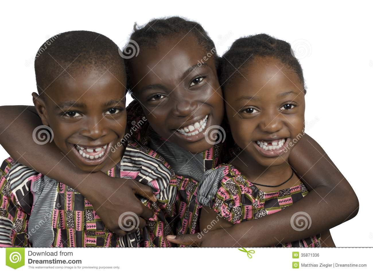 Three african kids holding on another smiling