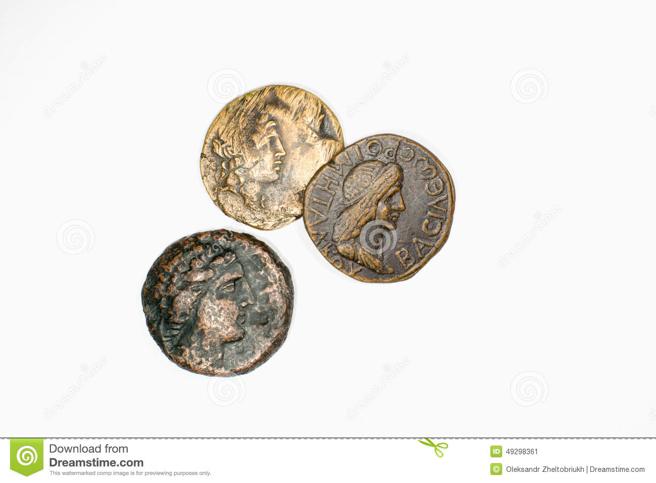 Three antique coins with portraits on a white background