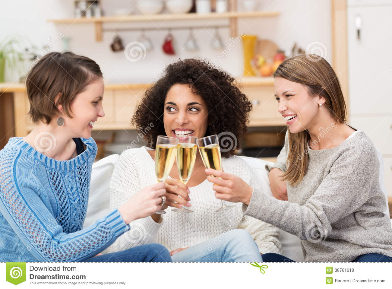 Three Attractive Women Celebrating With Champagne Stock