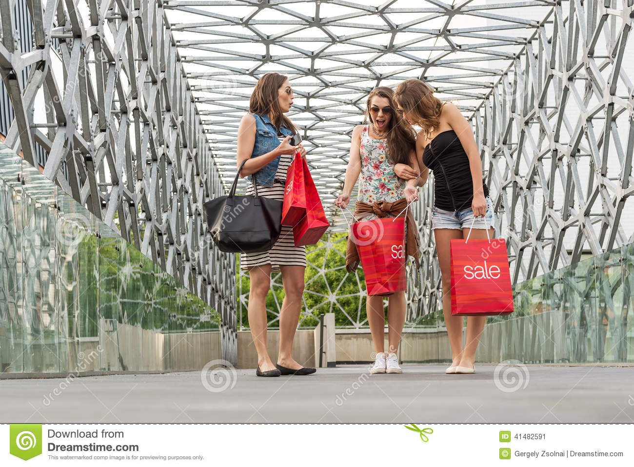 1e83283171 Three beautiful woman walking on the bridge, They Were shopping, shopping  bag in his