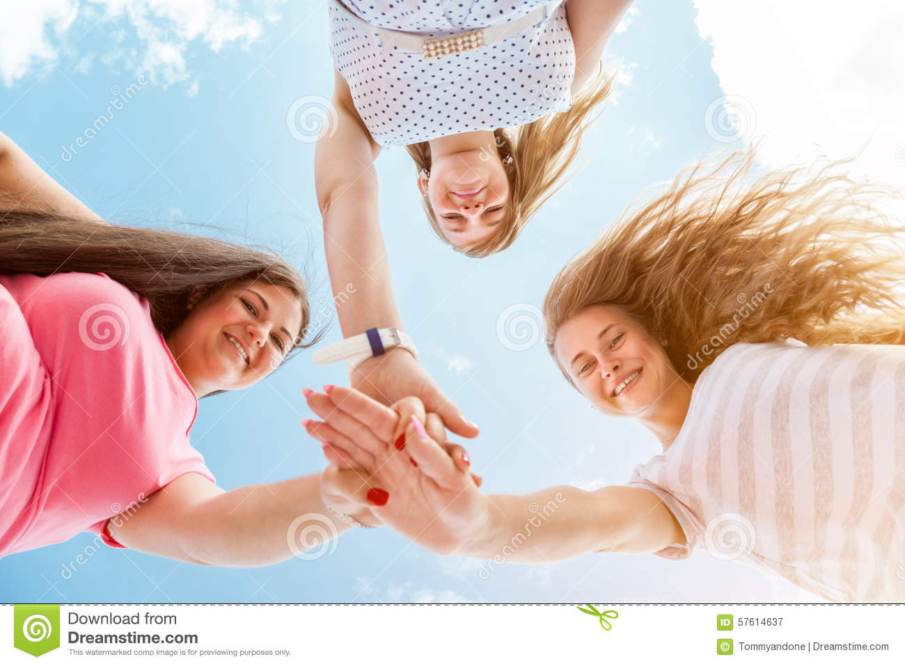 three best friends looking down and holding hands stock image