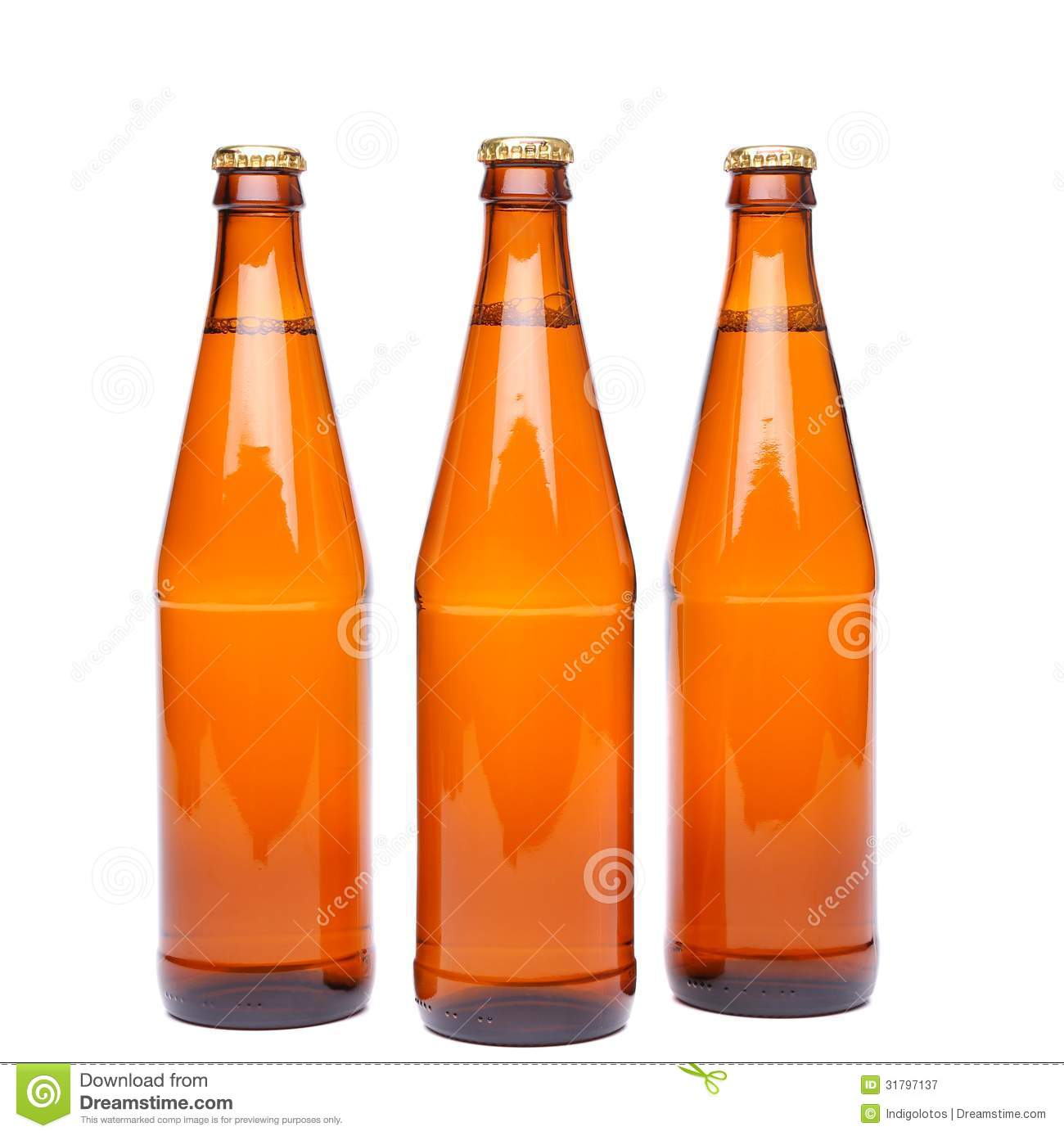 Three brown beer bottle with drops drink without label on a white