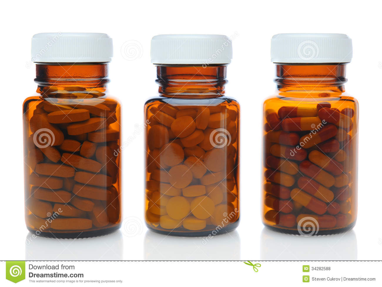 Three Brown Medicine Bottles With Different Drugs Royalty