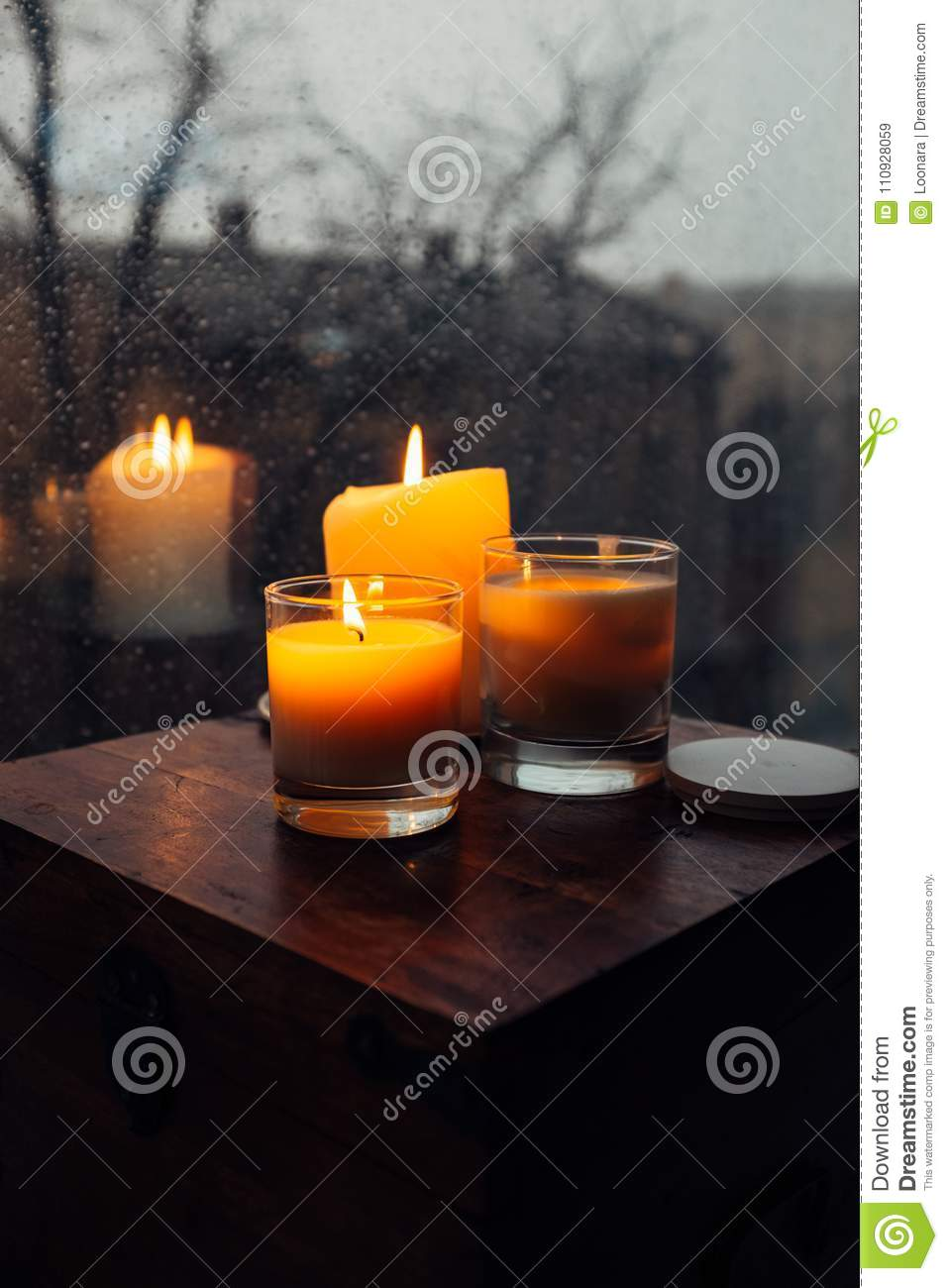 Three Burning Candles On Table, Cozy Rainy Day An Home Stock ... on riverside home, sunny day home, garden home, easter home, gloomy day home, cloudy day home, fun home, health home, black and white home, paul reubens home, cold home, blu home, farm home,