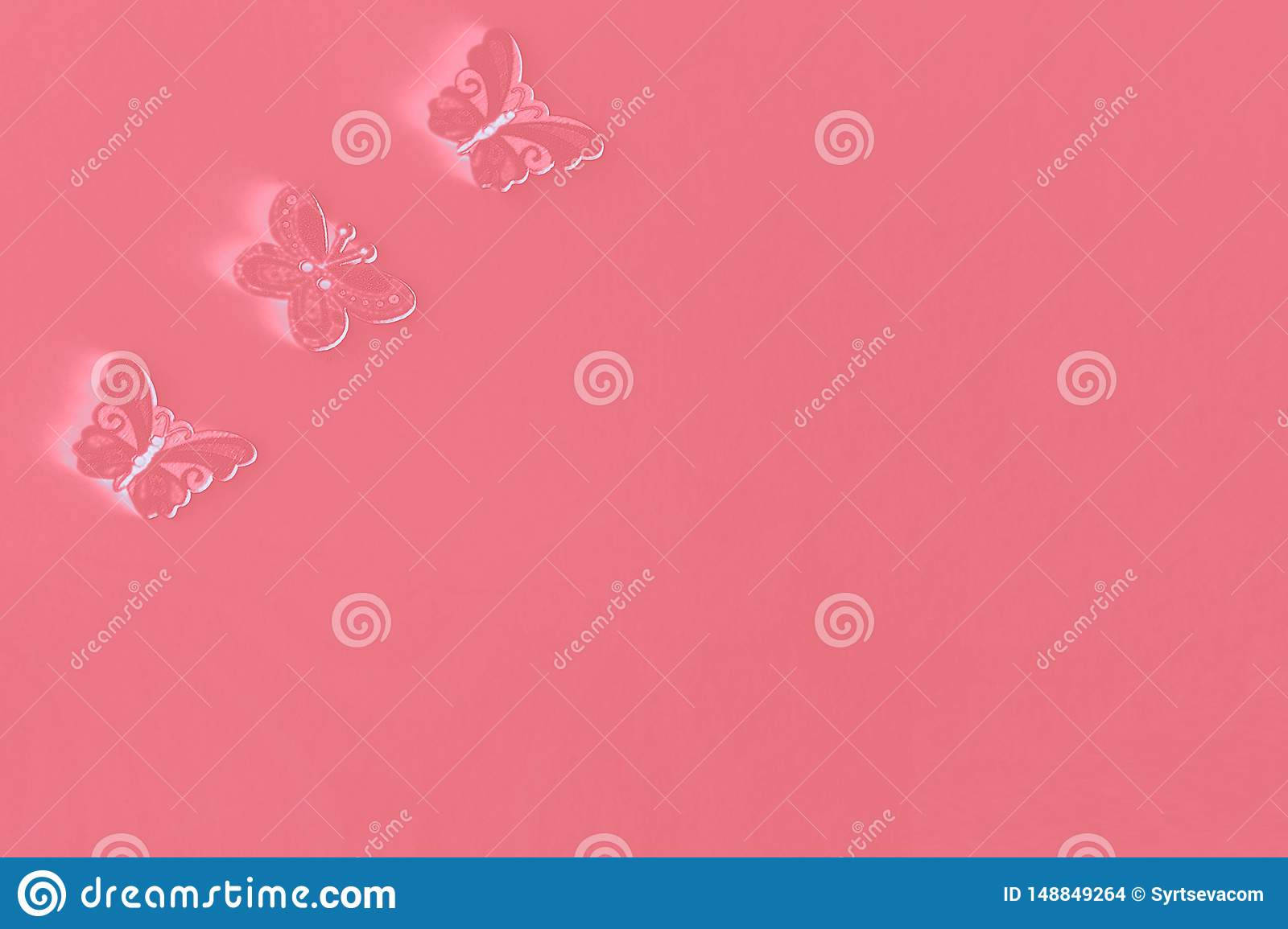 Three butterflies in the corner of the sheet, on a pink background, space for text