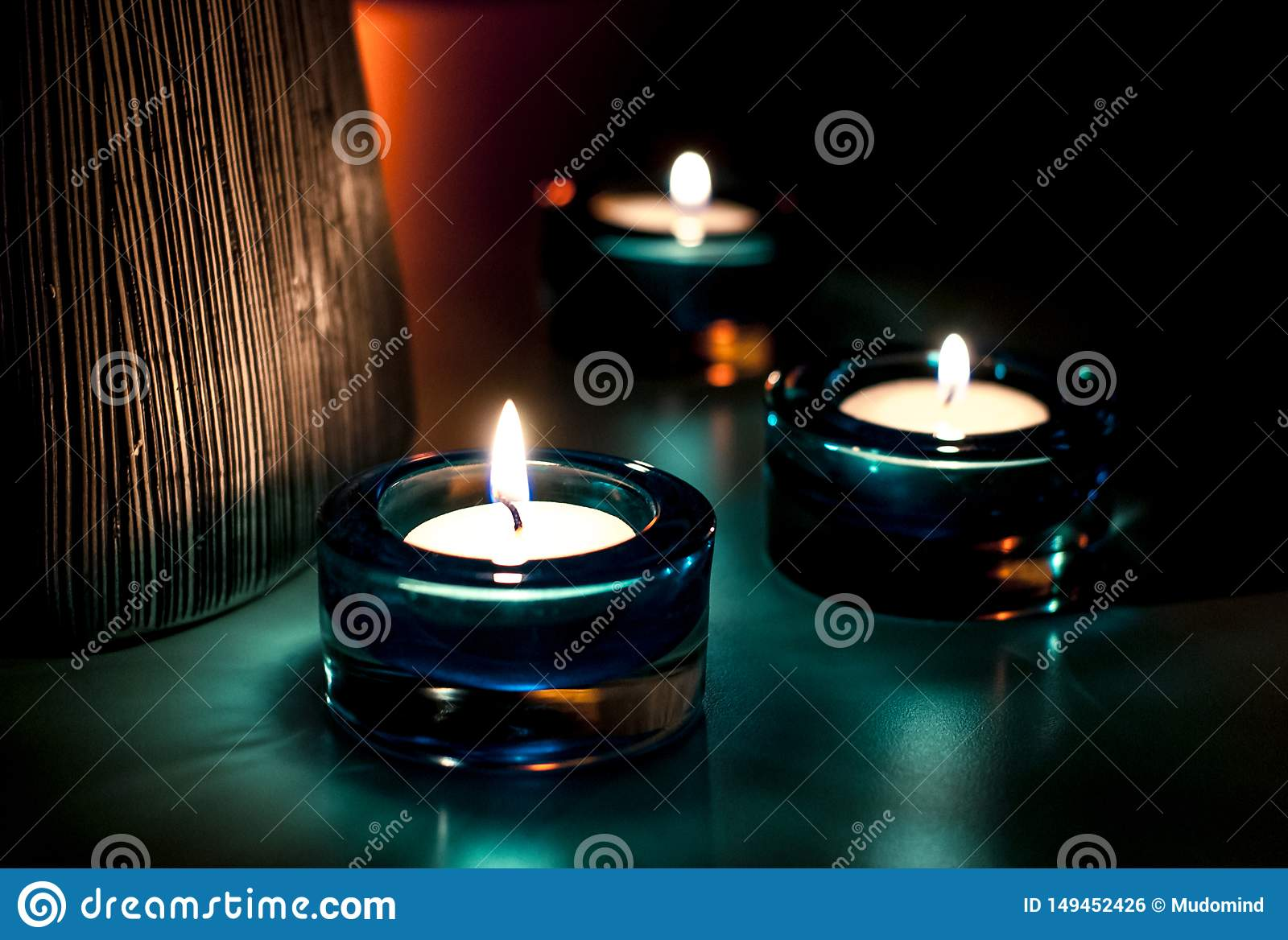 Three candles in the night.
