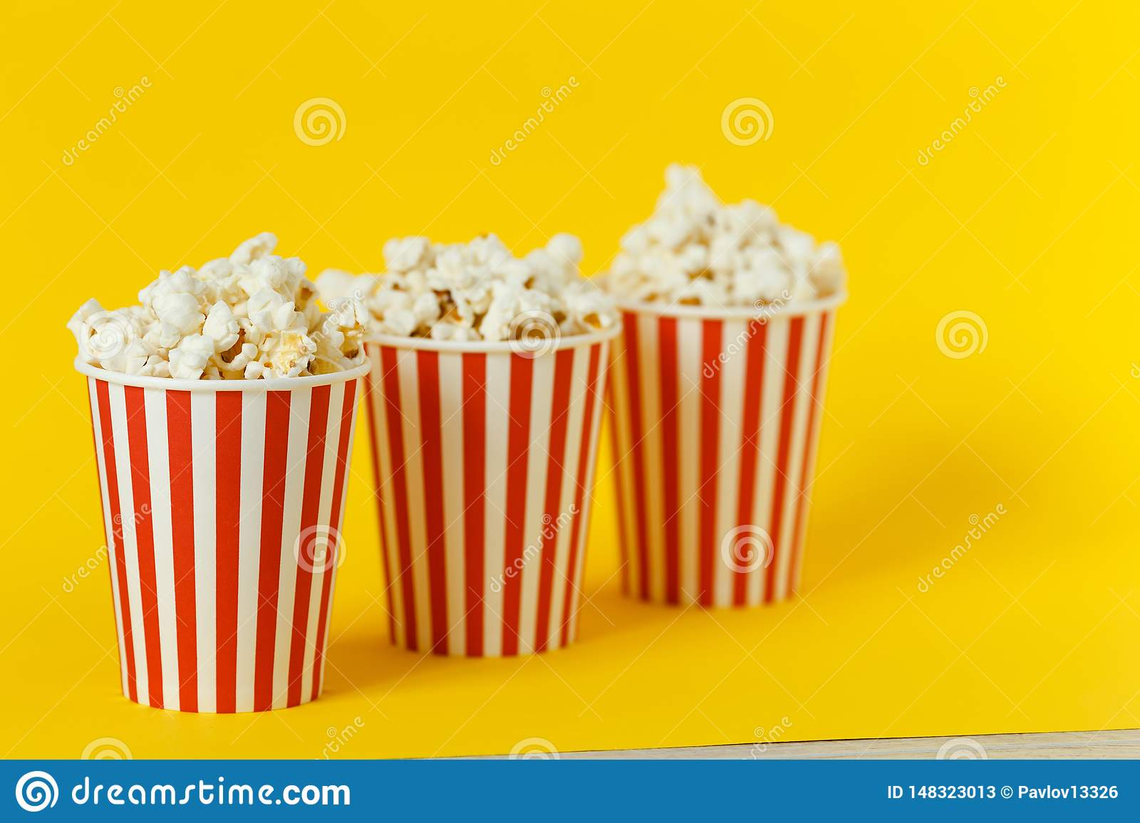 Three Carton Bucket With Cinema Snack Popcorn And Red Cups On Color Yellow Background Space For Text Stock Image Image Of Film Closeup 148323013