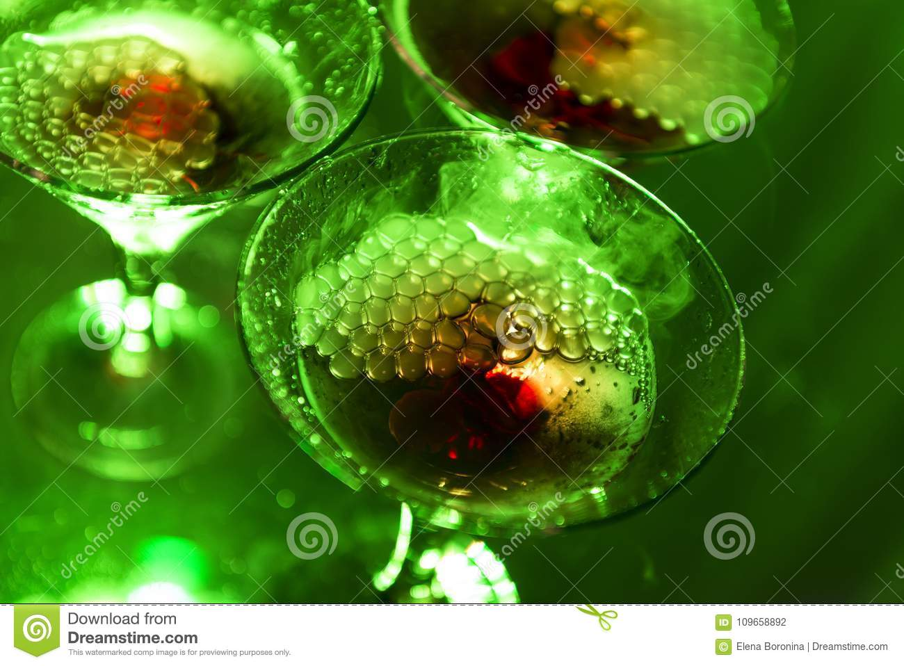 Three, 3 champagne glass in green color, bubbly, alcoholic drink