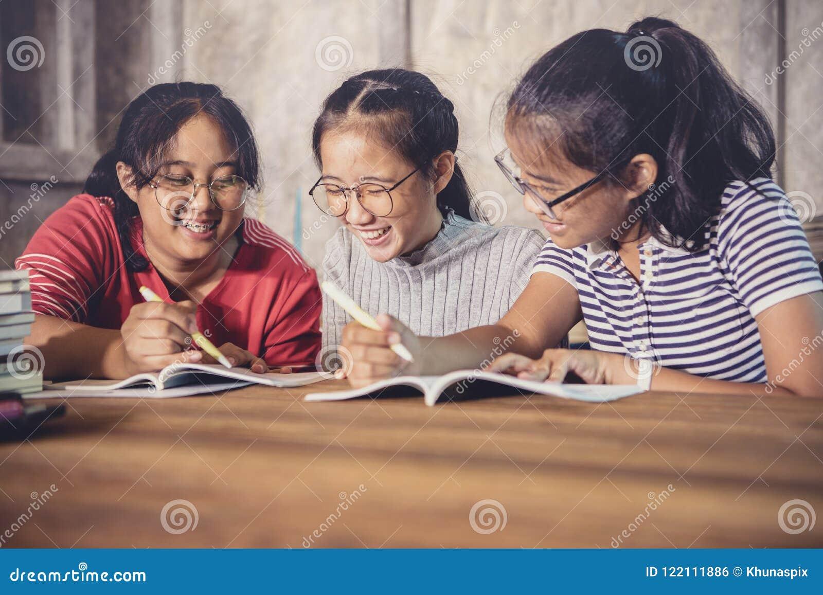 Three of cheerful asian teenager tutorial for school homework ha