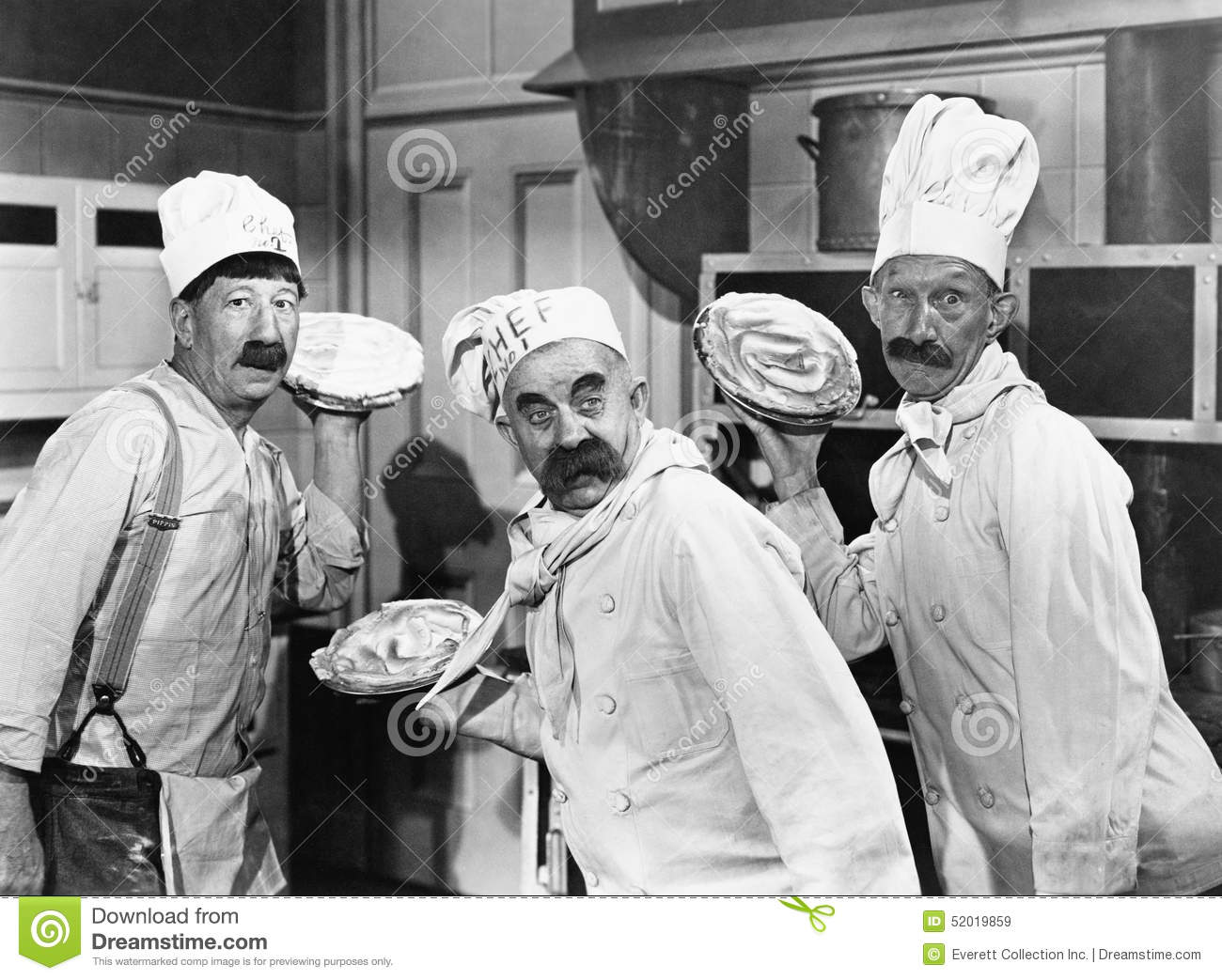 Three Chefs Holding Pies For A Fight In The Kitchen Stock Image ...