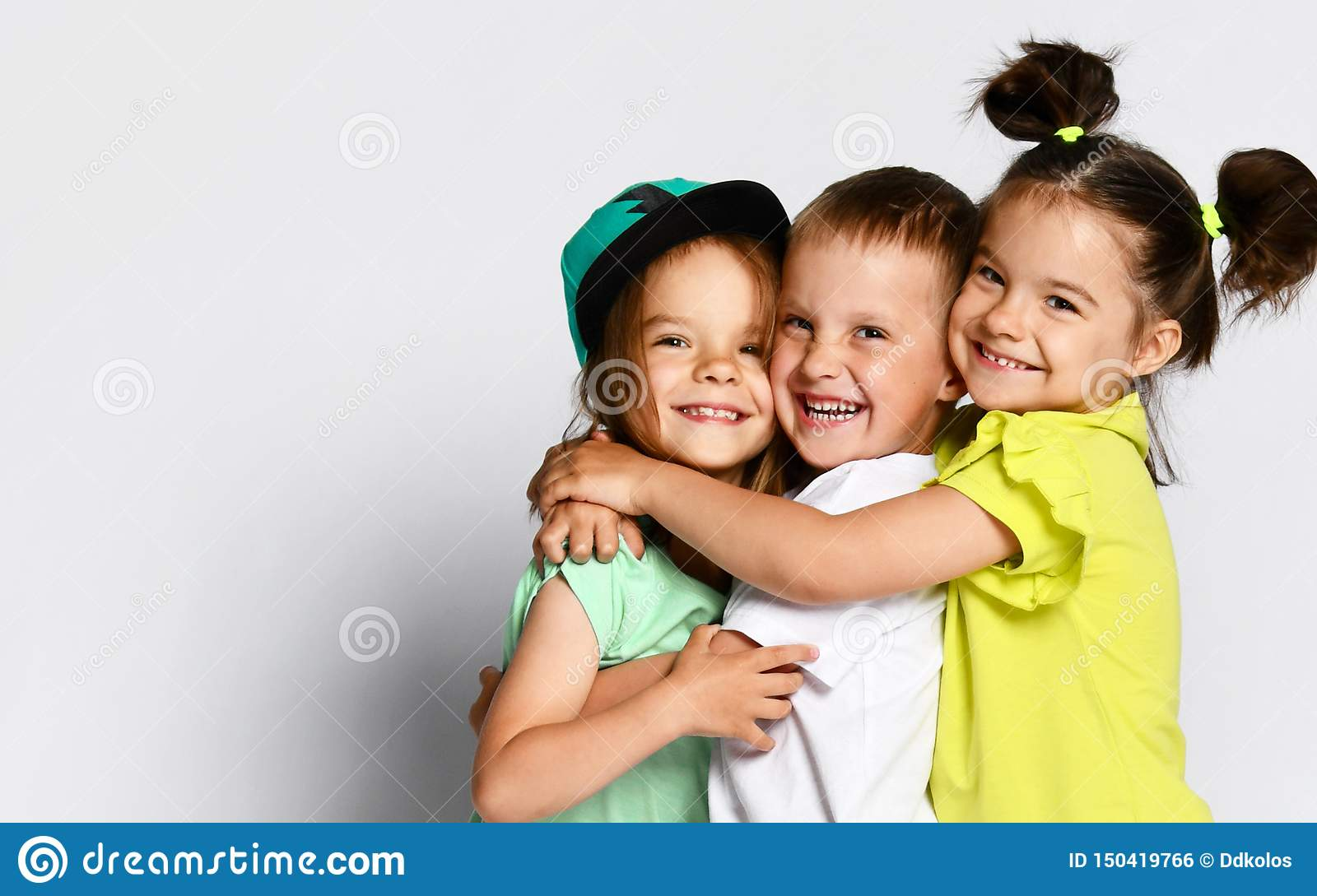 Three Children In Bright Clothes Two Girls And One Boy Triplets