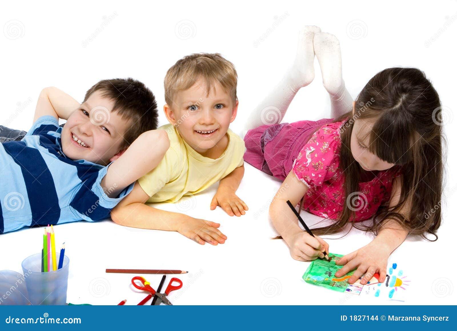 Three Children Happily Drawing
