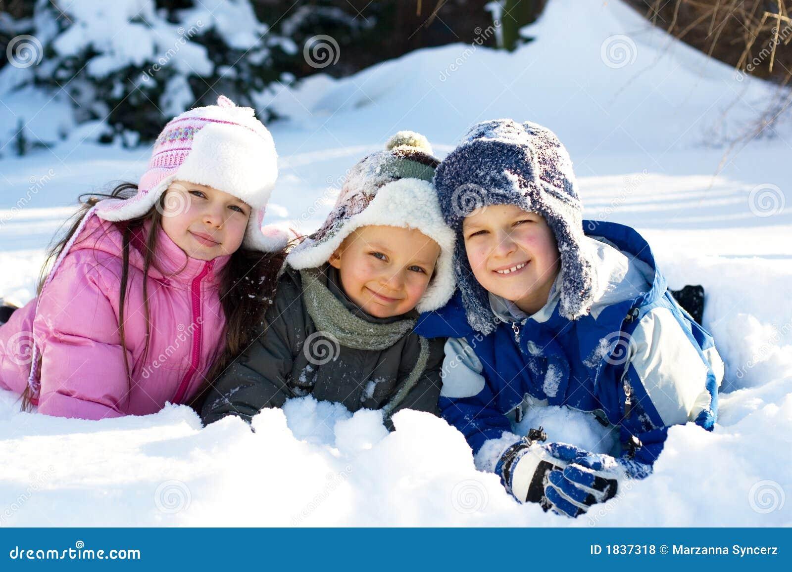 Three Children Playing In Snow Stock Photo - Image: 1837318