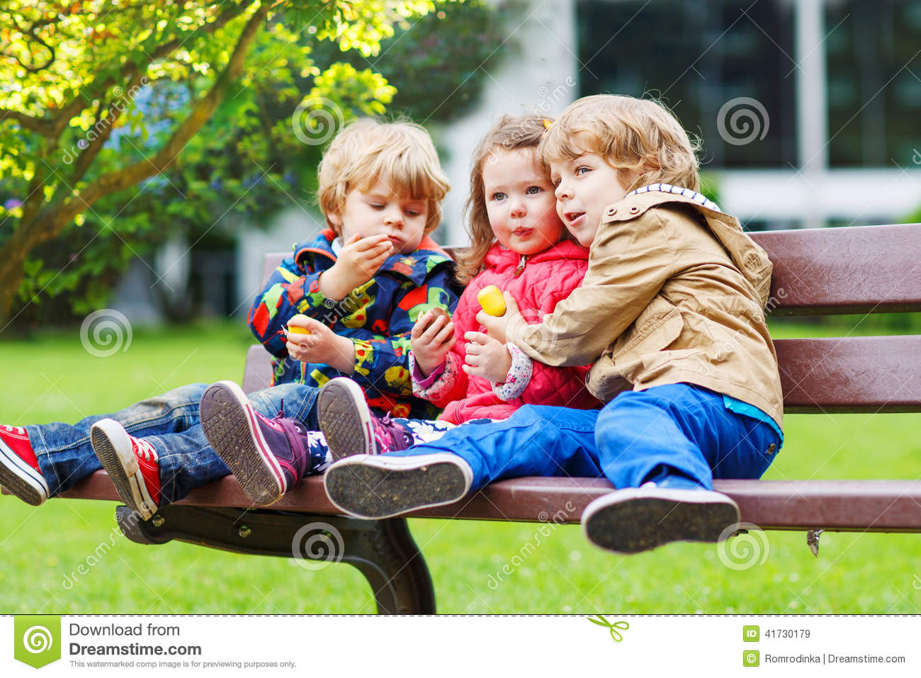 Three Children: Two Little Boys And One Girl Hugging  Stock