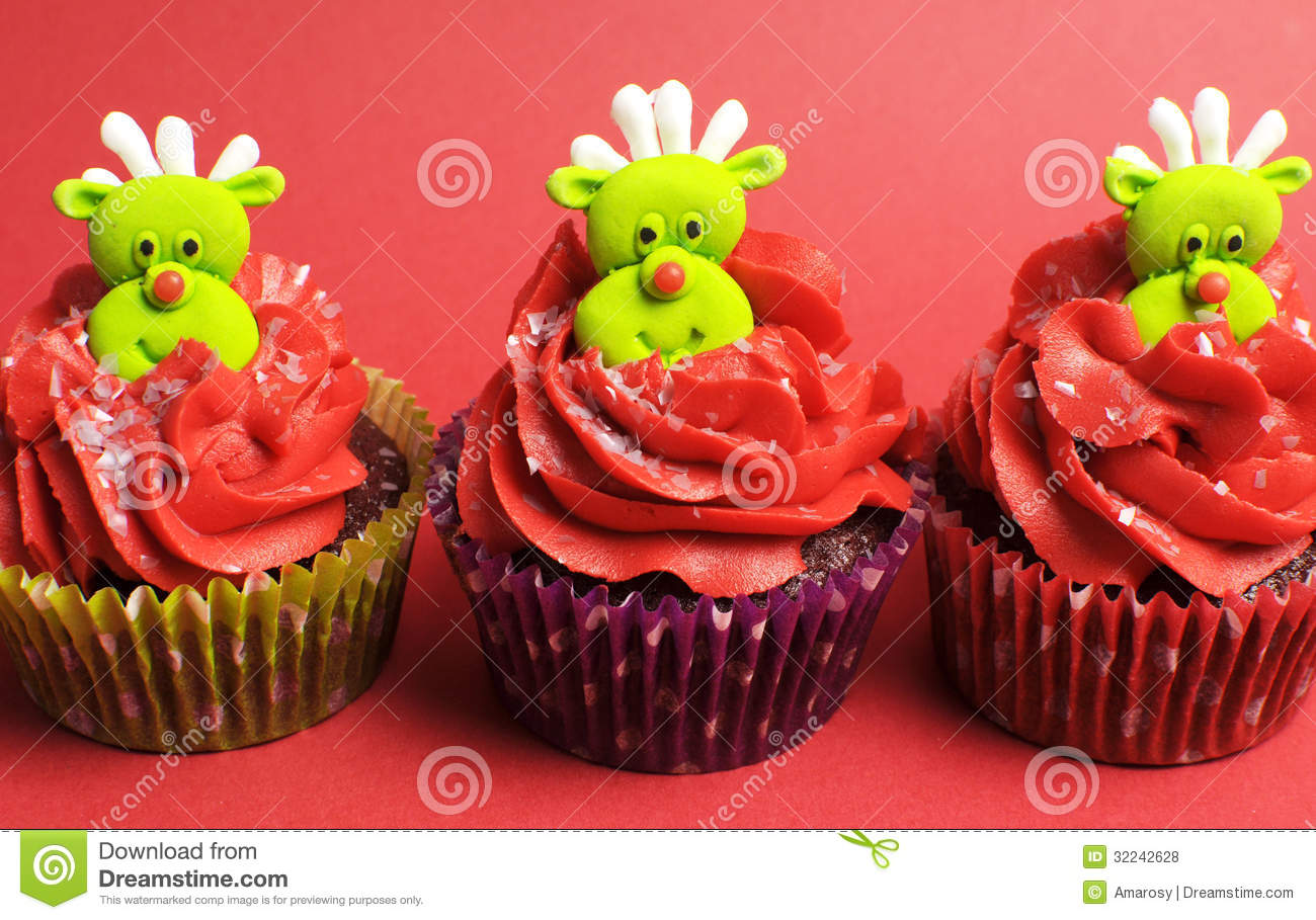 Three Christmas Cupcakes With Fun And Quirky Reindeer Faces Stock