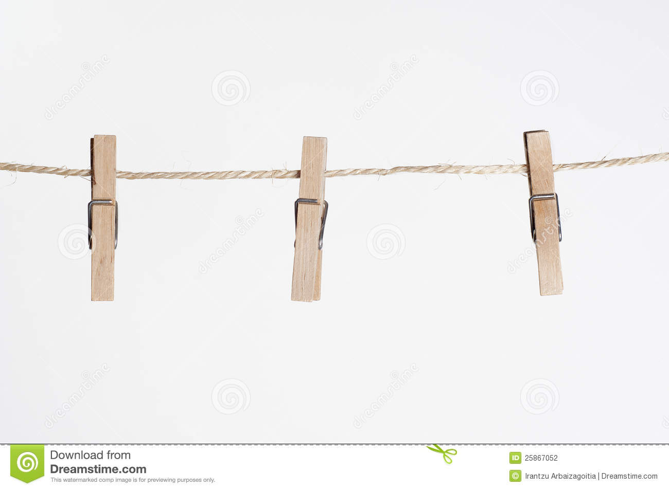 Three Clamps For Laundry Hanging On A String Stock