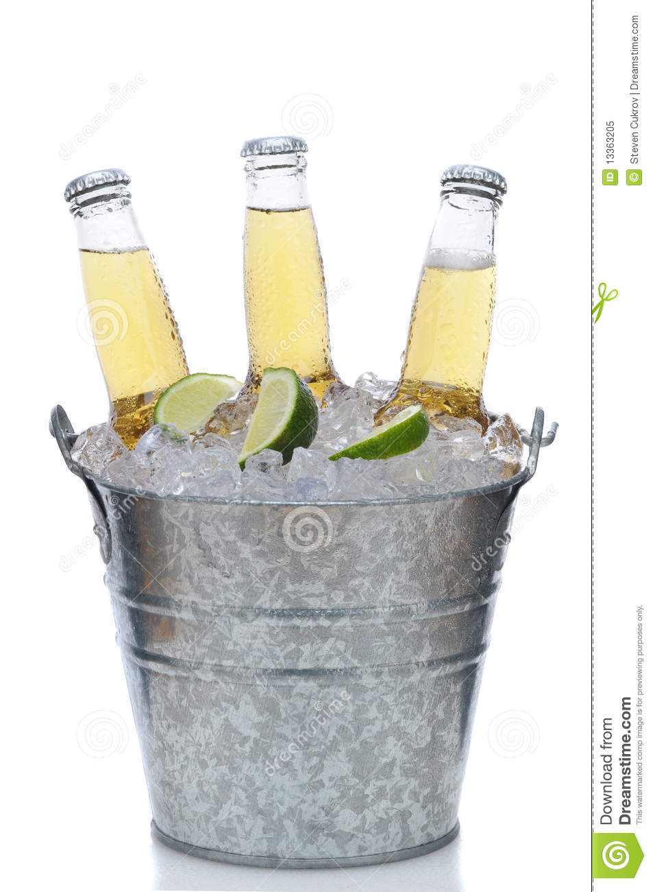 Three Clear Beer Bottles In Ice Bucket Royalty Free Stock