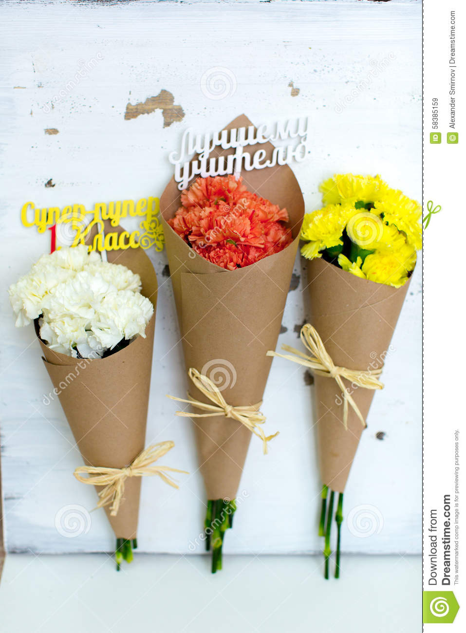 Three colored bouquet of carnations in paper cornet