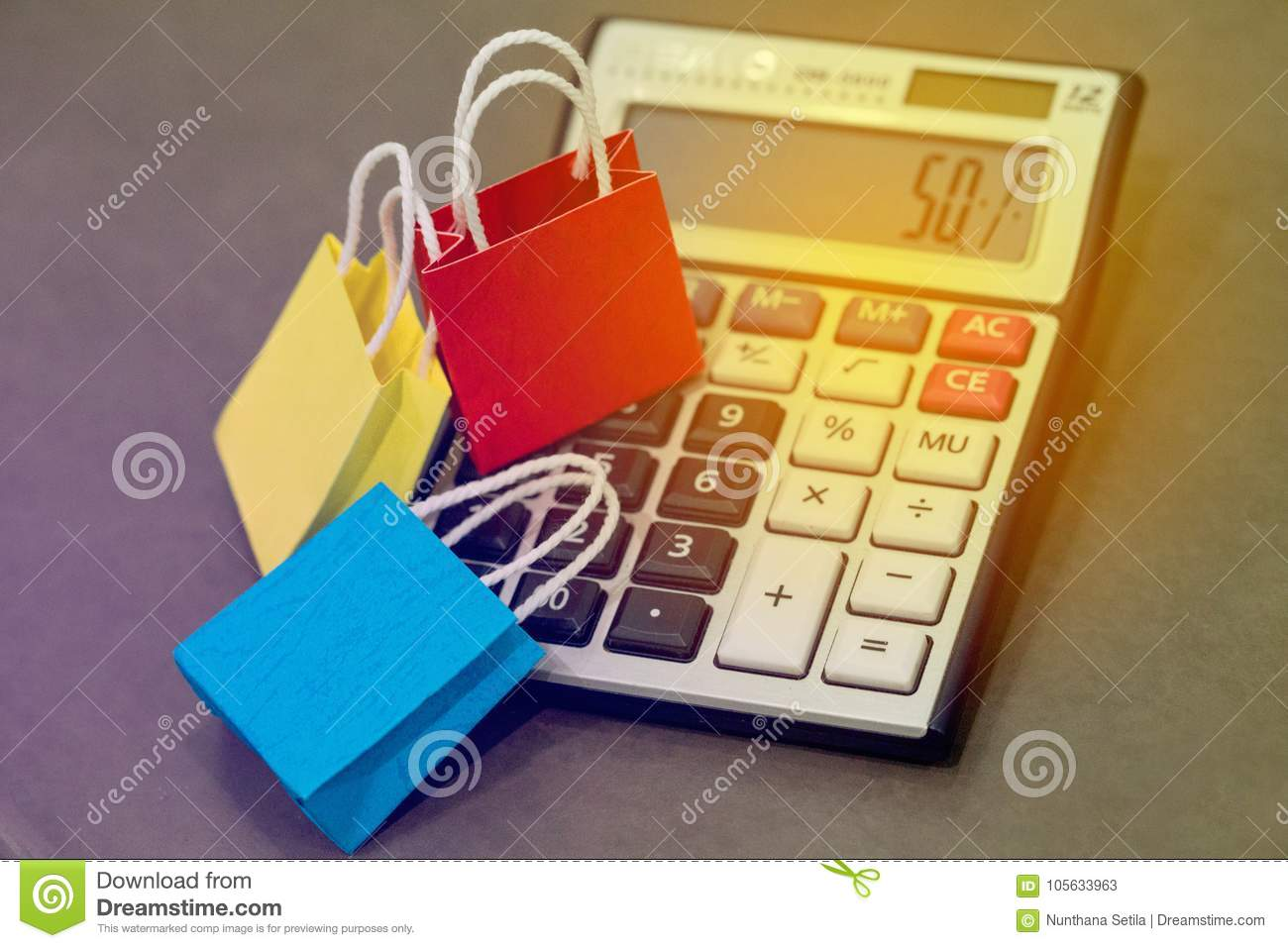 three colorful paper shopping bags on a calculator ideas for di