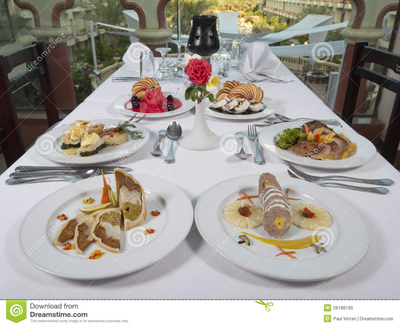 Russian Ala-carte Table Setting : Two settings of three course meals in an a la carte restaurant with ...