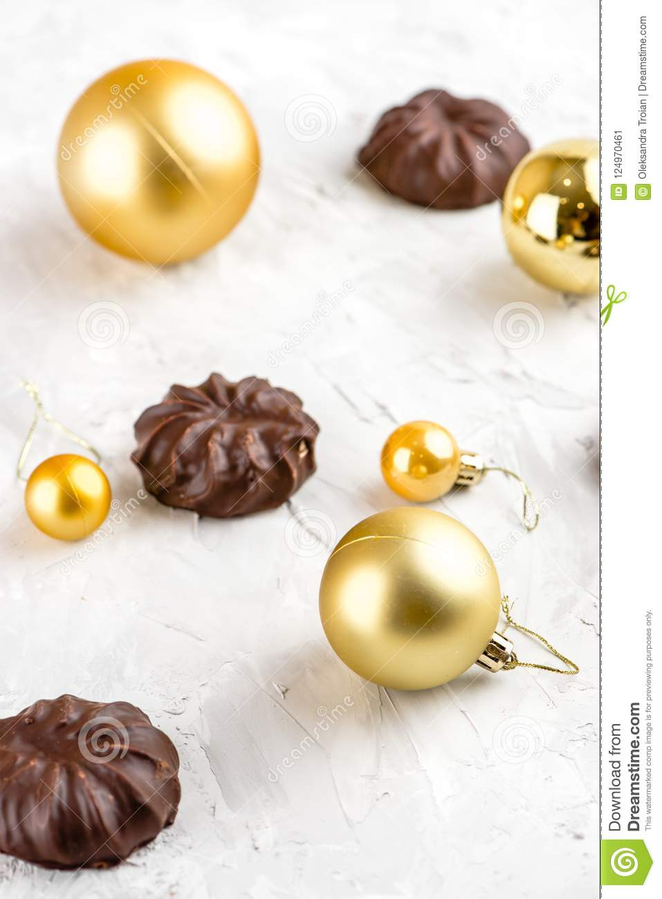 Three dark chocolate-coated zefir top view isolated on white background airy with christmas ornaments
