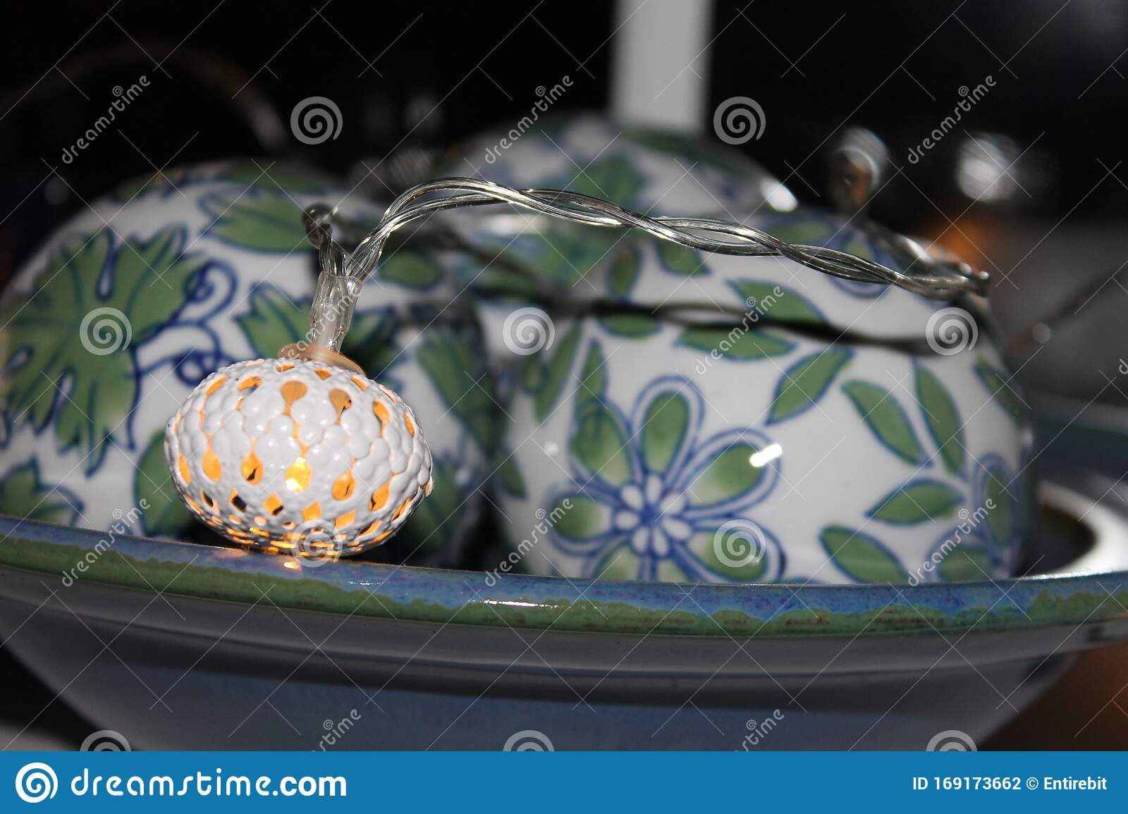 Three Ceramic Decorative Balls In A Bowl With A Fairy Light Stock Photo Image Of Beautiful Bowl 169173662