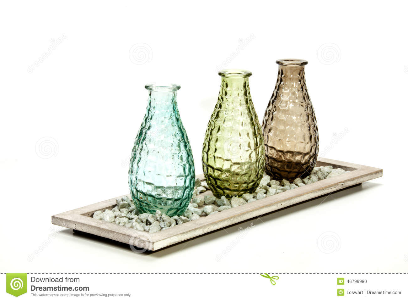 Three decorative glass vases on stand with pebbles