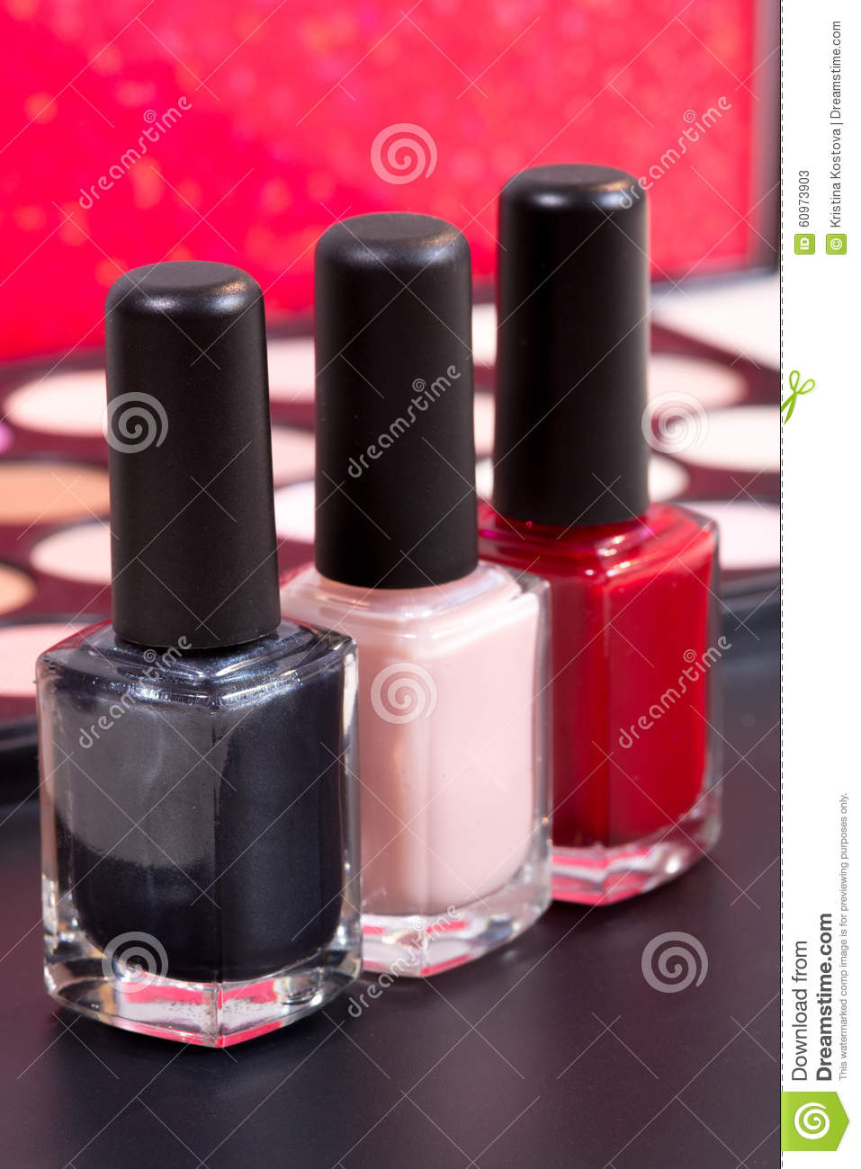 Three Different Nail Polish Colors And A Make Up ...